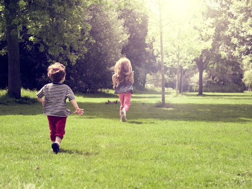 Happy children running at mead
